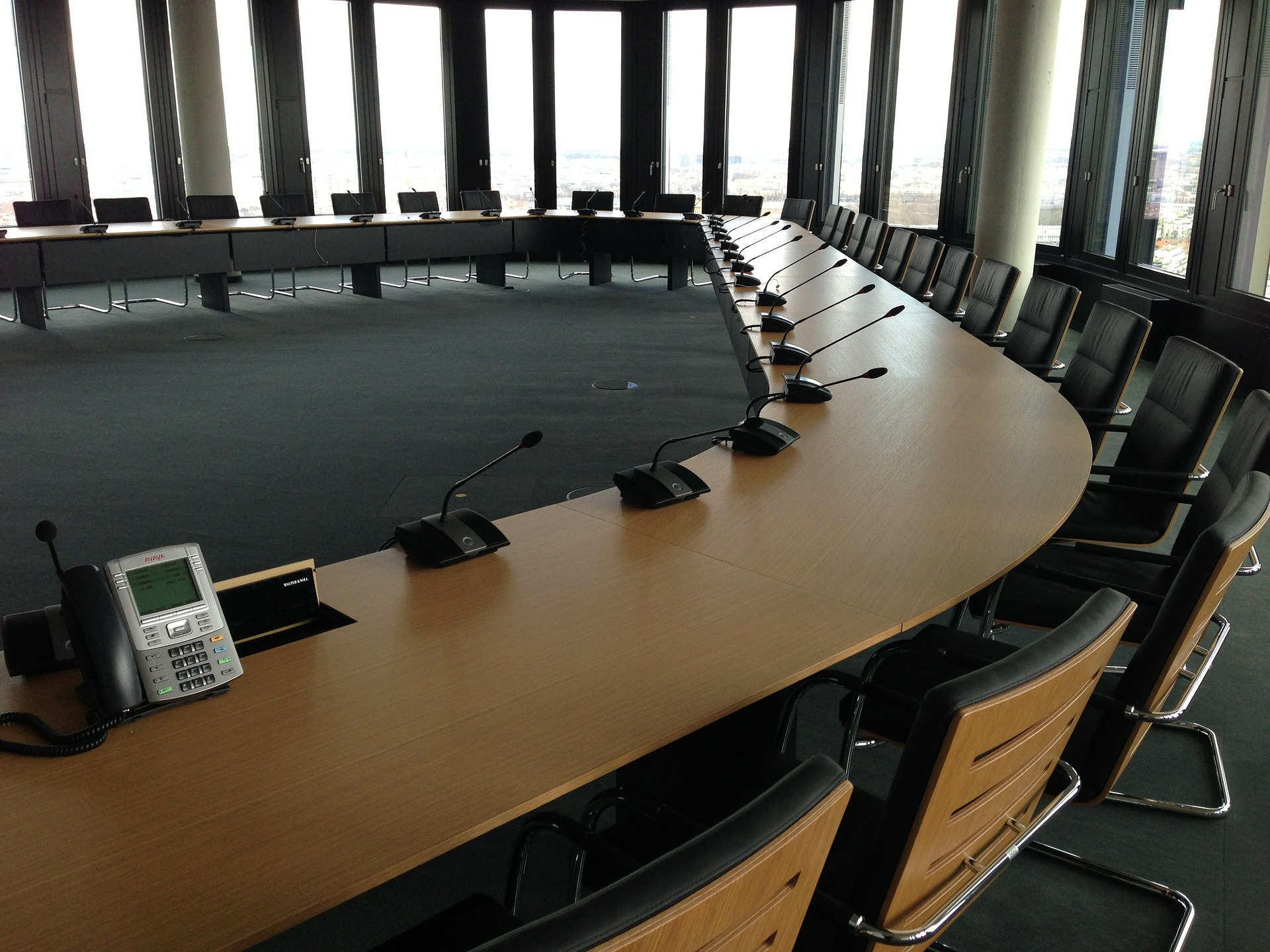Empty meeting table - experts can't solve poverty